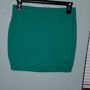 Kelly green Material Girl mini skirt